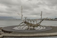 Iceland - Reykjavik. The dreamboat statue called Sun Voyager during daylight against a grey cloudy sky. This statue is located at Saebraut in Reykjavik, Iceland Stock Photo