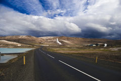 Iceland road. Road through colored and vulcanic landscape, Iceland Royalty Free Stock Photography