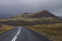 Iceland road. Highway in Iceland with a mountain in the background Royalty Free Stock Photos