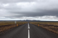 Iceland road leading straight to the far away. Royalty Free Stock Images