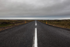 Iceland road leading straight to the horizon. Royalty Free Stock Image