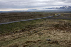 Iceland. A road and mountains in the background in interior of Iceland Royalty Free Stock Photography