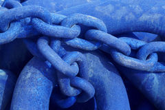 Iceland. Rusted metallic chain in blue tone close up. Royalty Free Stock Images