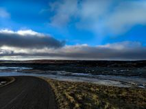 Iceland`s hillside road stock photo