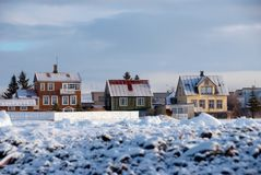 Iceland's houses. Three coloured houses with snow in Reykjavik, Iceland royalty free stock image