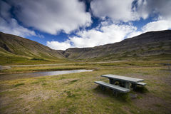 Iceland Scenery. Beautiful Iceland Nature, with small stream and a picnic bench Royalty Free Stock Images