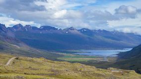 Iceland - September , 2014 - road trip in ring road iceland, green yellow grass fjord mountain. Stock Image