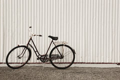 Iceland. Seydisfjordur. Antique bike and white facade. Royalty Free Stock Image