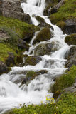 Iceland. Seydisfjordur. Waterfall and basaltic rocks. Royalty Free Stock Image