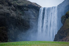 Iceland Skogafoss Waterfall Landscape With Mountain Moss On The Ground. Long Exposure Royalty Free Stock Image