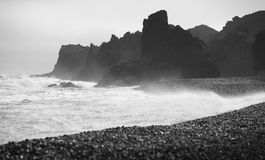 Iceland. Snaefellnes Peninsula. Dritvik. Volcanic rocks and blac Royalty Free Stock Photos