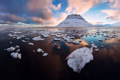 Iceland snaefellsnes peninsula and famous Kirkjufell. Kirkjufell is a beautifully shaped and a symmetric, free standing mountain. Iceland snaefellsnes peninsula royalty free stock photos