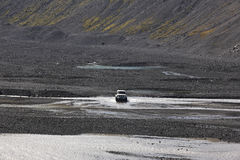 Iceland. South area. Eyjafjalajokul volcanic sand, river and 4wd Royalty Free Stock Photography