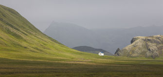 Iceland. South area. Fjallabak. Volcanic landscape with farm. Stock Photo
