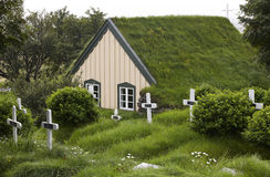 Iceland. Southeast area. Hof. Cemetery and church with peat roof Royalty Free Stock Photos