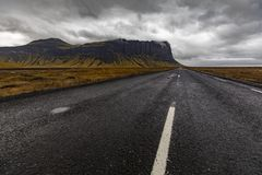 Iceland - Southern region - Ring road. Driving the ring road in Iceland`s southern region. An empty road. A cloudy day. Dramatic view Stock Image