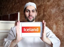 Iceland Supermarkets chain logo. Logo of Iceland Supermarkets chain on samsung tablet holded by arab muslim man. Iceland is a British supermarket chain, with Royalty Free Stock Photography