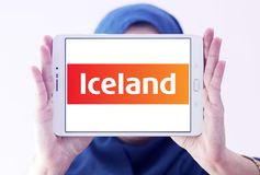 Iceland Supermarkets chain logo. Logo of Iceland Supermarkets chain on samsung tablet holded by arab muslim woman. Iceland is a British supermarket chain, with Stock Photography