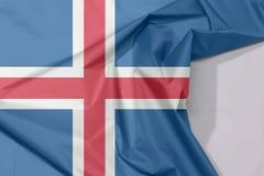 Iceland tkaniny flaga zagniecenie z biel przestrzenią i krepa zdjęcia royalty free