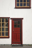 Iceland. Traditional wood facade with red windows and a door. Stock Photography