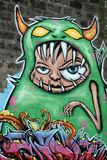 Iceland Travel. Graffiti is seen in a park on a park wall in Reykjavik, Iceland Royalty Free Stock Photography