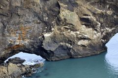 Iceland. Vik / Iceland - August 15, 2017: A arc stone view from Dyrholaey promontory, Vik, Iceland, Europe stock photography