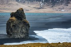 Iceland Vik south coast black volcanic beach shore with waves and mountains. Dyrholaey rock on the south coast of Iceland, Vik Iceland royalty free stock photos