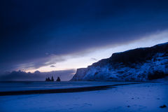 Iceland. Vik Town local volcanic black sand beach Myrdalur  cold winter  amazing sunset dramatic sky Iceland Atlantic Ocean Stock Photo