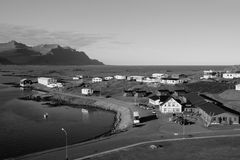 Iceland village. Iceland, Djupivogur - small fishing town. Mountains and fjord. Black and white tone - retro monochrome color style Stock Images
