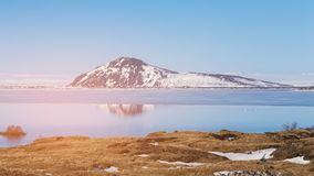 Iceland volcano with water lake with blue sky background stock images