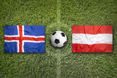 Iceland vs. Austria flags on soccer field Royalty Free Stock Images