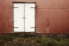 Iceland. Warehouse. Metallic facade and door. Royalty Free Stock Images