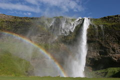 Iceland waterfall and rainbow Stock Photo