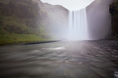 Iceland waterfall Skogafoss in Icelandic nature landscape. Famous tourist attractions and landmarks destination in Icelandic royalty free stock photo