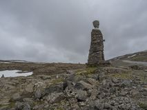 Iceland, West fjords, Isafjordur, June 25, 2018: Big Kleifabui Statue made from natural stones at Kleifaheidi Pass, West stock images