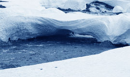 Iceland. West fjords. River, snow and ice blocks. Stock Photography