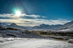 Iceland winter landscape view with blue sky and sunlight cold fr. Eezing snow. This photo was taken in Iceland near Reykjavik and Akureyri in November stock images
