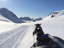 Iceland in winter. Snowmobile tour in Icelandic highlands, beautiful landscape of mountains snow and glaciers Royalty Free Stock Photography