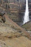 Iceland. Wschodni fiordy. Lagarfljot teren. Hengifoss b i siklawa Obraz Royalty Free