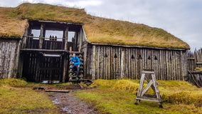 Iceland - A young man sitting at the stairs in a vikings village royalty free stock image