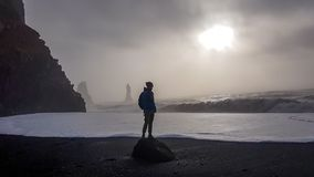Iceland - Young man standing on he Reynisfara royalty free stock image