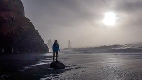 Iceland - Young man standing on he Reynisfara stock photography