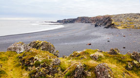 Icelandic beach with black lava rocks, Snaefellsnes peninsula, Iceland Royalty Free Stock Images
