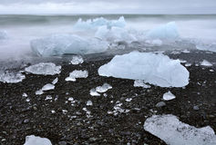 Icelandic black sand beach full of ice cubes and blocks. Famous Icelandic Jokulsarlon beach full of ice cubes on early summer Stock Photography