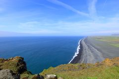 Icelandic black sand beach. Landscape in Dyrholaey in a sunny day Royalty Free Stock Photos