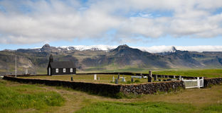 Icelandic black wooden church and cemetery royalty free stock image