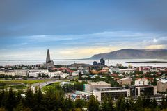 Icelandic capital panorama, streets and resedential buildings wi. Th fjord and mountains in the background, Reykjavik, Iceland Stock Photography