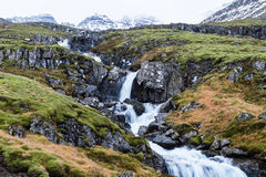 Icelandic cascade. In the misty winter morning Stock Photos