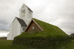 Icelandic Christian Church and traditional Viking house Royalty Free Stock Images
