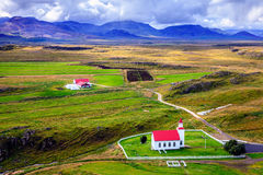 Icelandic church and farm Royalty Free Stock Images